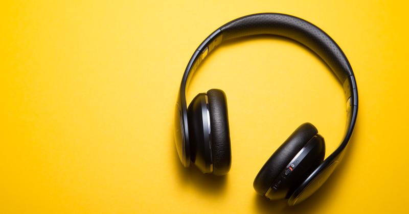 A wireless headset on yellow background.
